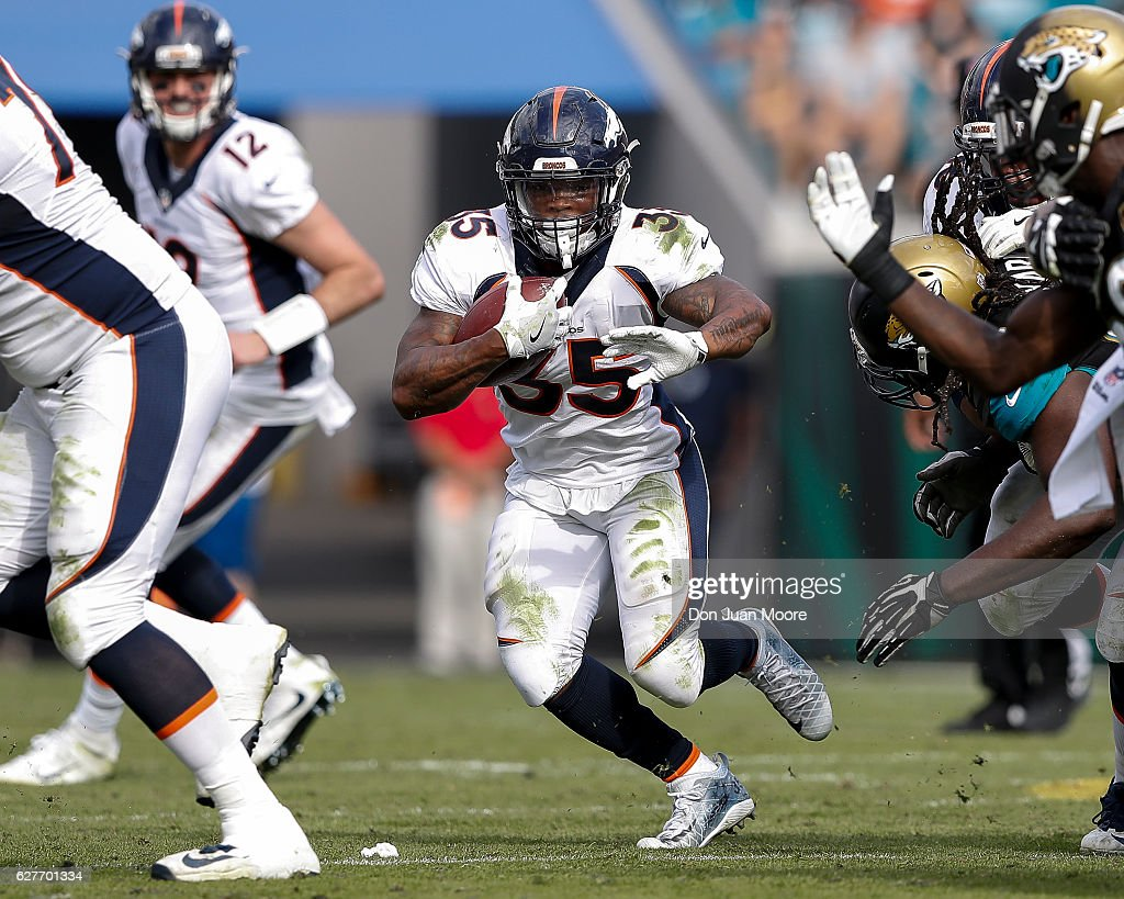 Running back Kapri Bibbs #35 of the Denver Broncos on a running play during the game against the Jacksonville Jaguars at EverBank Field on December 4, 2016 in Jacksonville, Florida. The Broncos defeated the Jaguars 20 to 10.