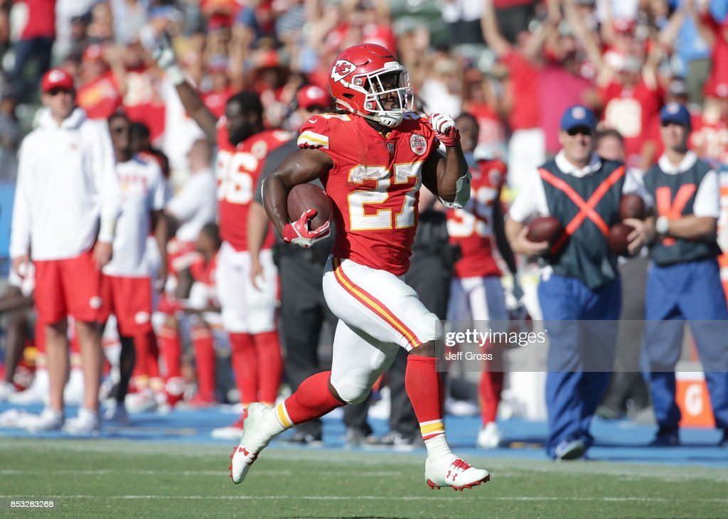Running back Kareem Hunt #27 of the Kansas City Chiefs carries the ball for a touchdown against the Los Angeles Chargers in the fourth quarter at StubHub Center on September 24, 2017 in Carson, California. The Chiefs defeated the Chargers 24-10.