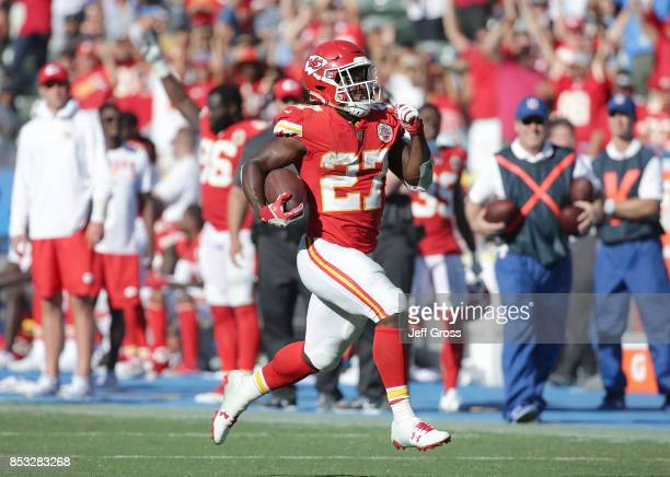 Running back Kareem Hunt of the Kansas City Chiefs carries the ball for a touchdown against the Los Angeles Chargers in the fourth quarter at StubHub...