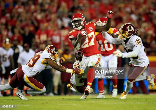 Running back Kareem Hunt of the Kansas City Chiefs carries the ball during the game against the Washington Redskins at Arrowhead Stadium on October 2...