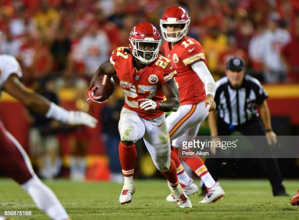 Running back Kareem Hunt of the Kansas City Chiefs rushes the ball against the Washington Redskins during the third quarter of the game against the...