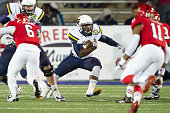 Running back Kareem Hunt of the Toledo Rockets carries the ball through traffic during their game against the Arkansas State Red Wolves on January 4...