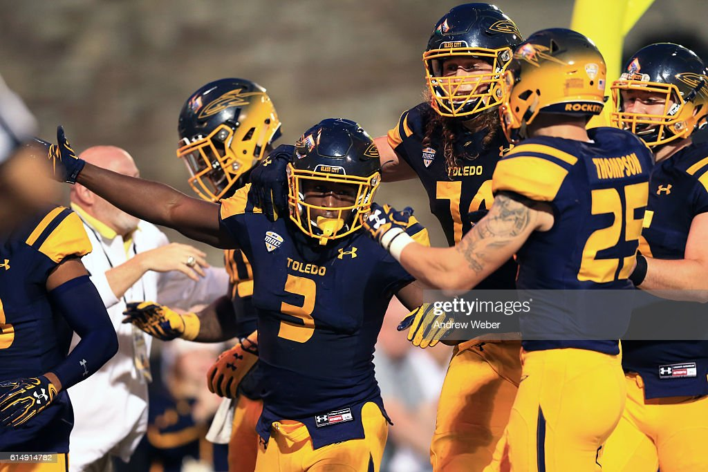 Running back Kareem Hunt #3 of the Toledo Rockets celebrates after scoring the game winning touchdown to defeat the Bowling Green Falcons 42-35 at Glass Bowl on October 15, 2016 in Toledo, Ohio.