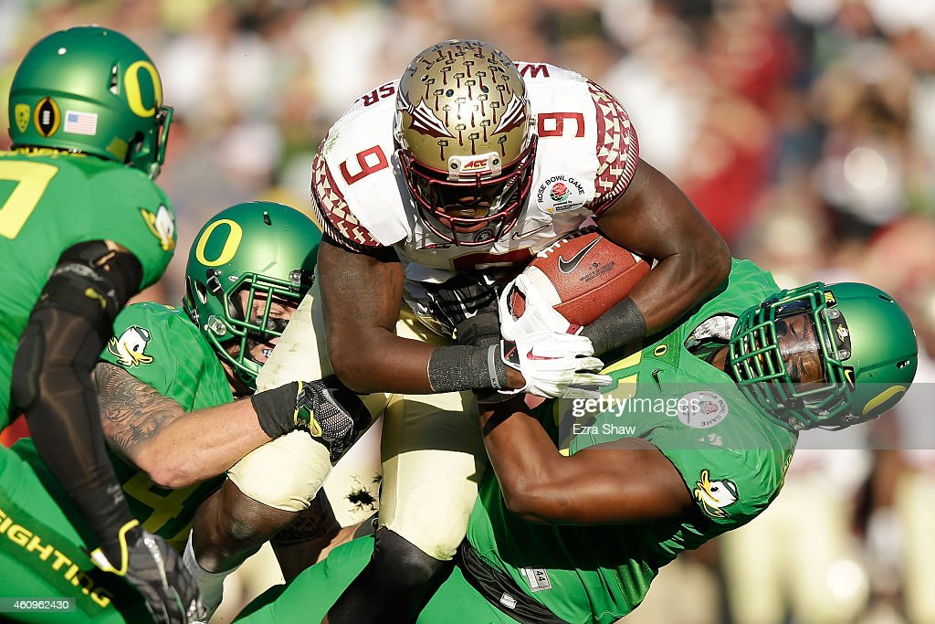 Running back Karlos Williams of the Florida State Seminoles rushes with the ball against the Oregon Ducks during the College Football Playoff...