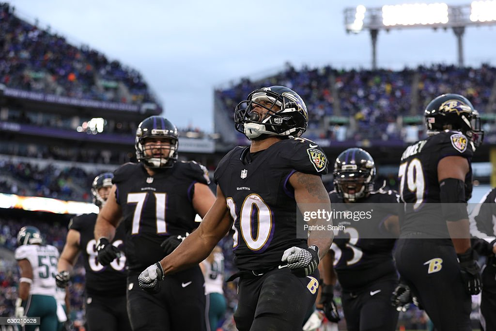 Running back Kenneth Dixon #30 of the Baltimore Ravens celebrates after scoring a fourth quarter touchdown against the Philadelphia Eagles at M&T Bank Stadium on December 18, 2016 in Baltimore, Maryland.