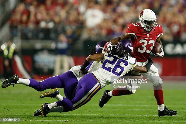 Running back Kerwynn Williams of the Arizona Cardinals rushes the football against cornerback Trae Waynes of the Minnesota Vikings during the second...