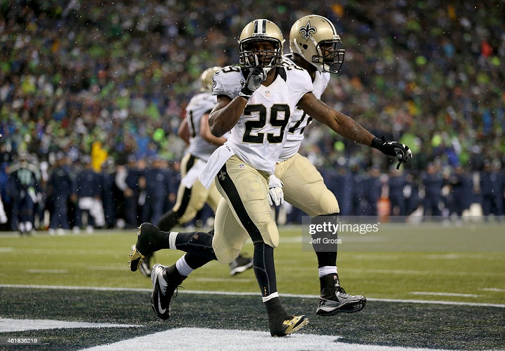Running back Khiry Robinson #29 of the New Orleans Saints celebrates after scoring on a one-yard touchdown run in the fourth quarter against the Seattle Seahawks during the NFC Divisional Playoff Game at CenturyLink Field on January 11, 2014 in Seattle, Washington.