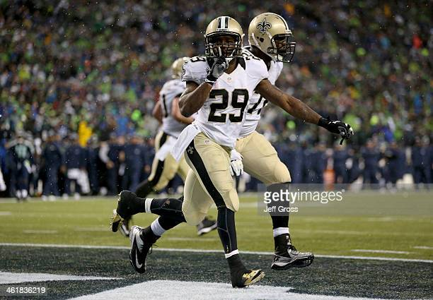 Running back Khiry Robinson of the New Orleans Saints celebrates after scoring on a oneyard touchdown run in the fourth quarter against the Seattle...