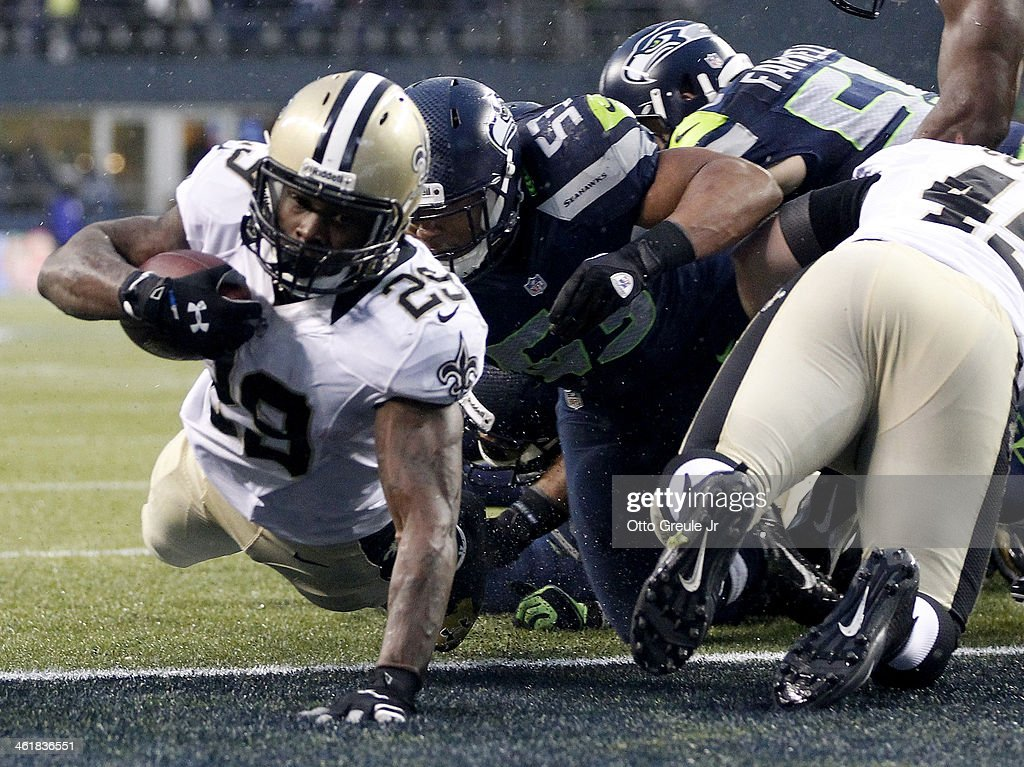 Running back Khiry Robinson of the New Orleans Saints dives into the endzone for a oneyard touchdown in the fourth quarter against the Seattle...