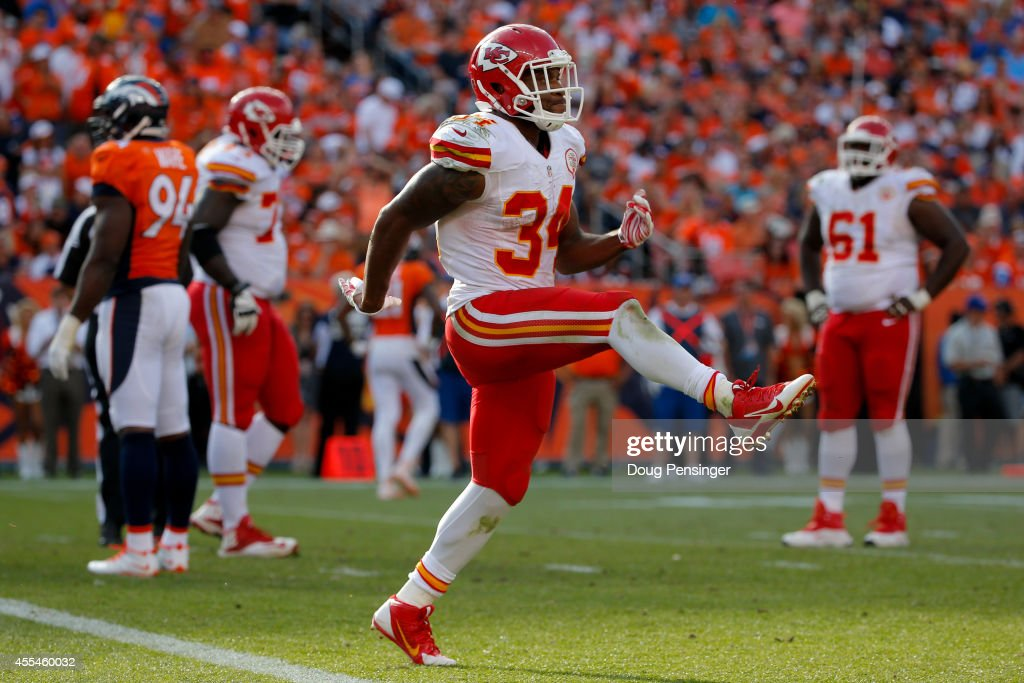 Running back Knile Davis #34 of the Kansas City Chiefs celebrates a fourth quarter touchdown against the Denver Broncos during a game at Sports Authority Field at Mile High on September 14, 2014 in Denver, Colorado.