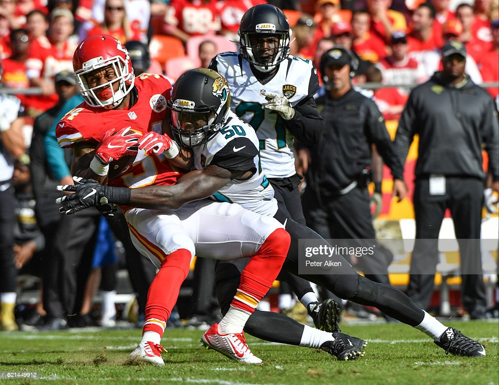 Running back Knile Davis #34 of the Kansas City Chiefs is tackled by outside linebacker Telvin Smith #50 of the Jacksonville Jaguars at Arrowhead Stadium during the second quarter of the game on November 6, 2016 in Kansas City, Missouri.