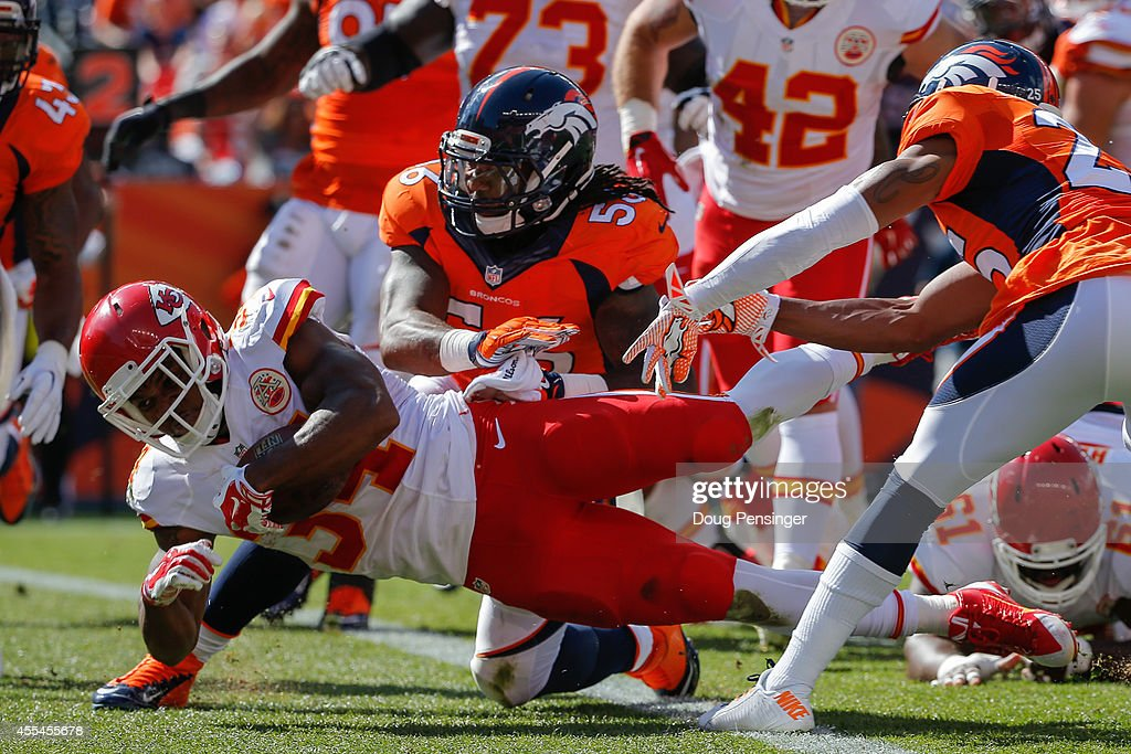 Running back Knile Davis #34 of the Kansas City Chiefs scores a touchdown on a 2 yard run in the second quarter of a game against the Denver Broncos at Sports Authority Field at Mile High on September 14, 2014 in Denver, Colorado.