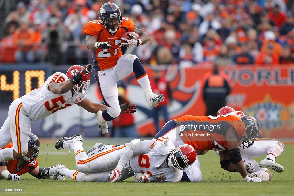 Running back <a gi-track='captionPersonalityLinkClicked' href=/galleries/search?phrase=Knowshon+Moreno&family=editorial&specificpeople=3986554 ng-click='$event.stopPropagation()'>Knowshon Moreno</a> #27 of the Denver Broncos jumps over a pile of defenders and past linebacker <a gi-track='captionPersonalityLinkClicked' href=/galleries/search?phrase=Derrick+Johnson+-+American+Football+Player&family=editorial&specificpeople=226781 ng-click='$event.stopPropagation()'>Derrick Johnson</a> #56 of the Kansas City Chiefs during the second quarter at INVESCO Field at Mile High on November 14, 2010 in Denver, Colorado.