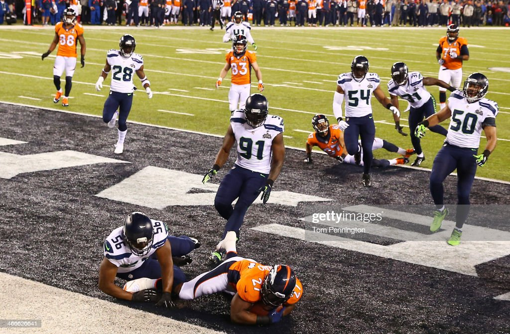 Running back <a gi-track='captionPersonalityLinkClicked' href=/galleries/search?phrase=Knowshon+Moreno&family=editorial&specificpeople=3986554 ng-click='$event.stopPropagation()'>Knowshon Moreno</a> #27 of the Denver Broncos recovers the ball in the endzone for a safety against the Seattle Seahawks during the first quarter of Super Bowl XLVIII at MetLife Stadium on February 2, 2014 in East Rutherford, New Jersey.