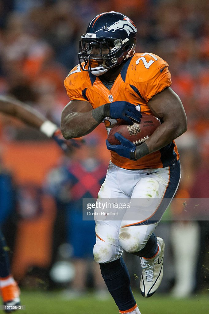 Running back <a gi-track='captionPersonalityLinkClicked' href=/galleries/search?phrase=Knowshon+Moreno&family=editorial&specificpeople=3986554 ng-click='$event.stopPropagation()'>Knowshon Moreno</a> #27 of the Denver Broncos rushes during a game against the Tampa Bay Buccaneers at Sports Authority Field Field at Mile High on December 2, 2012 in Denver, Colorado.