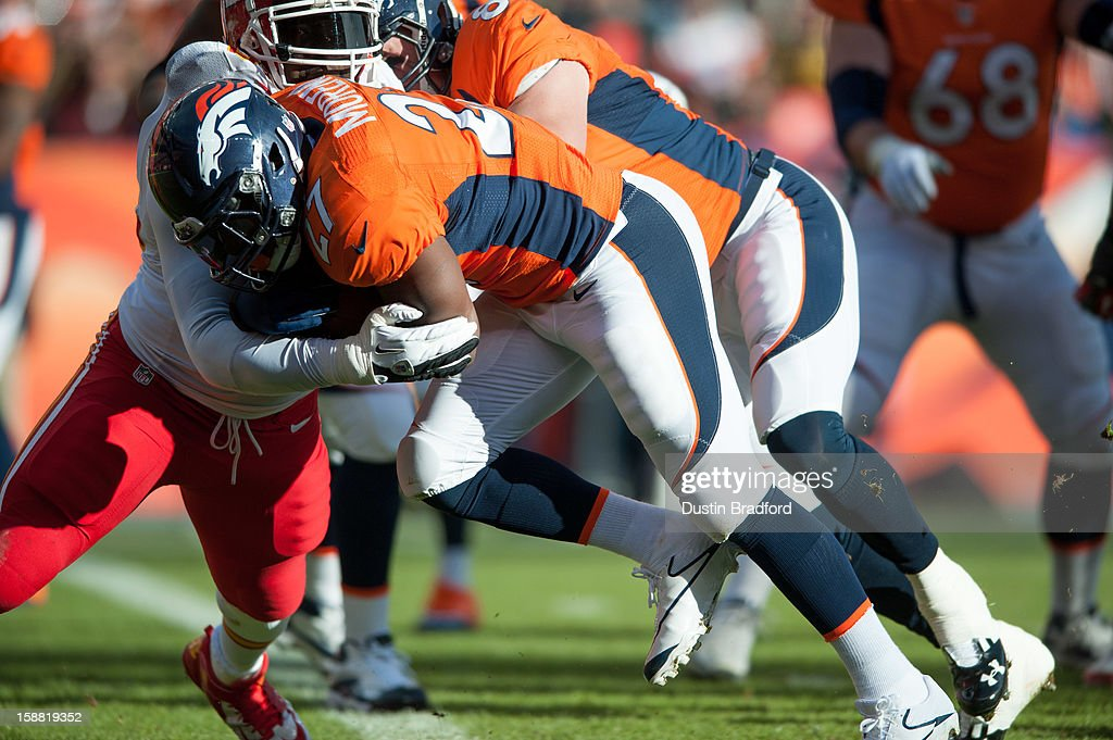 Running back Knowshon Moreno #27 of the Denver Broncos rushes for a first quarter touchdown during a game against the Kansas City Chiefs at Sports Authority Field Field at Mile High on December 30, 2012 in Denver, Colorado.