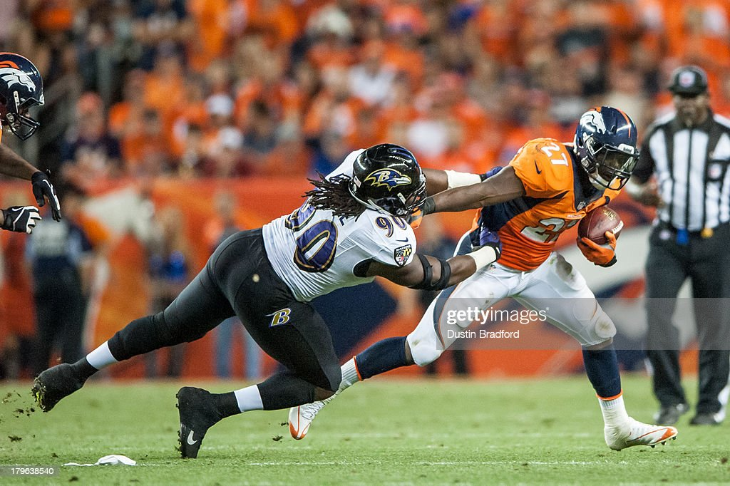 Running back <a gi-track='captionPersonalityLinkClicked' href=/galleries/search?phrase=Knowshon+Moreno&family=editorial&specificpeople=3986554 ng-click='$event.stopPropagation()'>Knowshon Moreno</a> #27 of the Denver Broncos rushes while being chased by linebacker <a gi-track='captionPersonalityLinkClicked' href=/galleries/search?phrase=Pernell+McPhee&family=editorial&specificpeople=6393111 ng-click='$event.stopPropagation()'>Pernell McPhee</a> #90 of Baltimore Ravens during the game at Sports Authority Field at Mile High on September 5, 2013 in Denver Colorado.