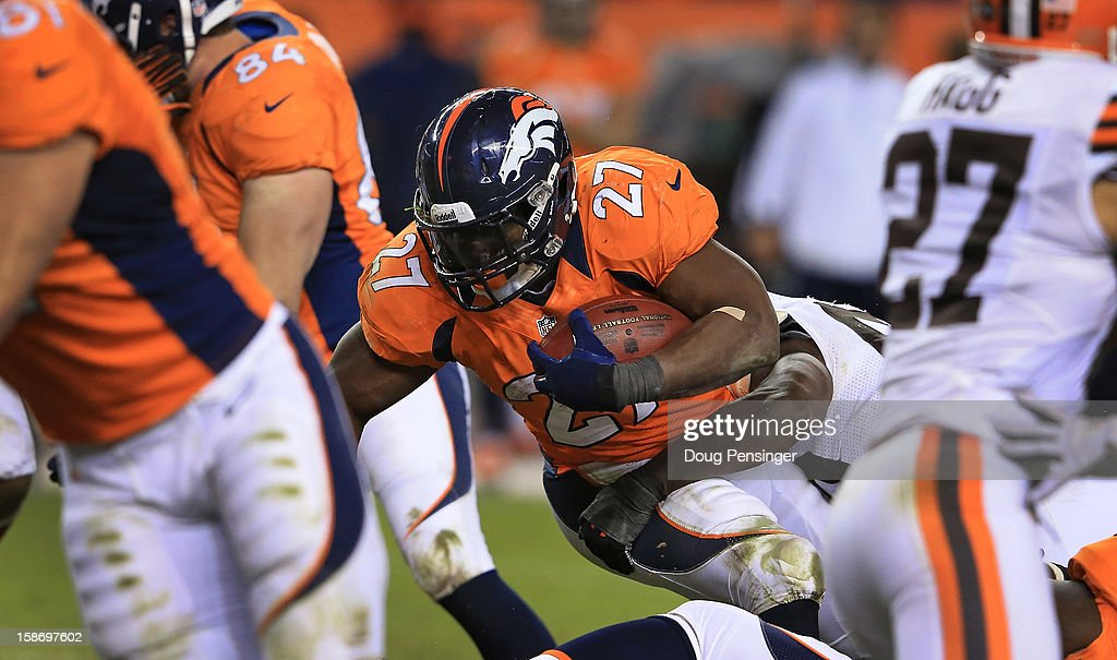 Running back <a gi-track='captionPersonalityLinkClicked' href=/galleries/search?phrase=Knowshon+Moreno&family=editorial&specificpeople=3986554 ng-click='$event.stopPropagation()'>Knowshon Moreno</a> #27 of the Denver Broncos rushes with the ball against the Cleveland Browns at Sports Authority Field at Mile High on December 23, 2012 in Denver, Colorado. The Broncos defeated the Browns 34-12.