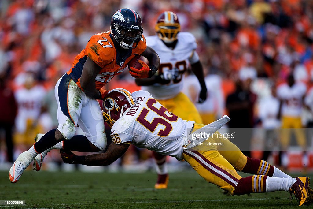 Running back <a gi-track='captionPersonalityLinkClicked' href=/galleries/search?phrase=Knowshon+Moreno&family=editorial&specificpeople=3986554 ng-click='$event.stopPropagation()'>Knowshon Moreno</a> #27 of the Denver Broncos tries to jump over linebacker <a gi-track='captionPersonalityLinkClicked' href=/galleries/search?phrase=Perry+Riley&family=editorial&specificpeople=4797857 ng-click='$event.stopPropagation()'>Perry Riley</a> #56 of the Washington Redskins during the third quarter at Sports Authority Field Field at Mile High on October 27, 2013 in Denver, Colorado. The Broncos defeated the Redskins 45-21.