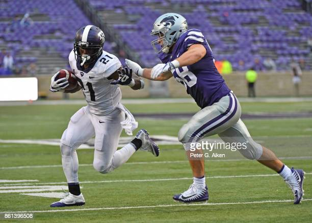 Running back Kyle Hicks of the TCU Horned Frogs runs to the outside against linebacker Trent Tanking of the Kansas State Wildcats during the second...