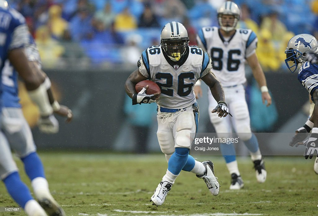 Running back Lamar Smith #26 of the Carolina Panthers runs with the ball during the NFL game against the Detroit Lions at Ericsson Stadium on September 15, 2002 in Charlotte, North Carolina. The Panthers won 31-7.
