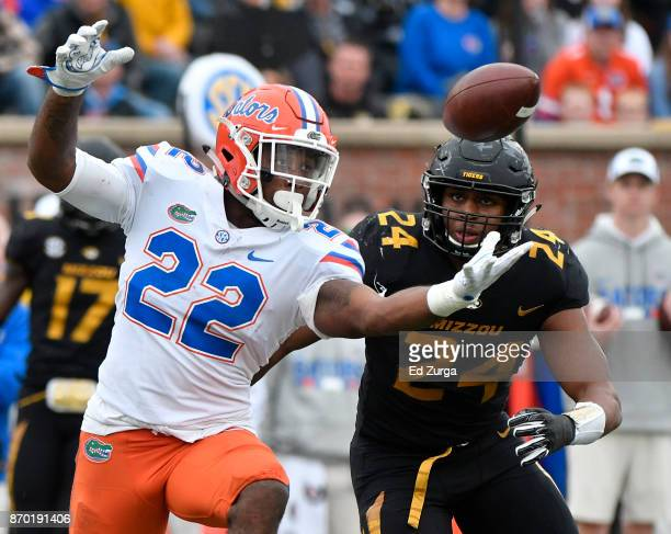 Running back Lamical Perine of the Florida Gators reaches out to catch a pass against Terez Hall of the Missouri Tigers in the fourth quarter at...