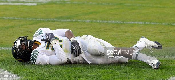 Running back LaMichael James of the Oregon Ducks writhes in pain after having a pass reception go through his hands in the fourth quarter of the game...