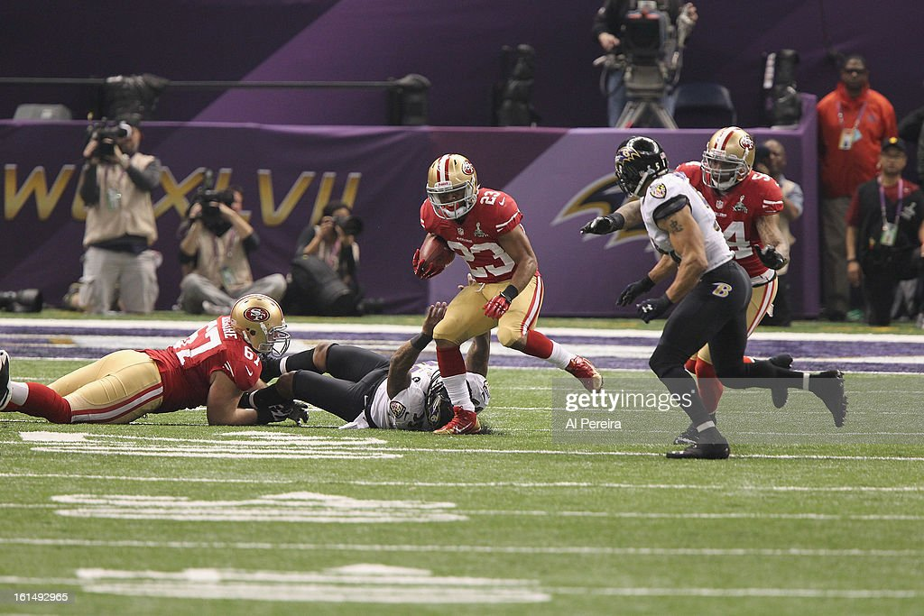 Running Back LaMichael James #23 of the San Francisco 49ers has a long gain against the Baltimore Ravens during Super Bowl XLVII at Mercedes-Benz Superdome on February 3, 2013 in New Orleans, Louisiana.