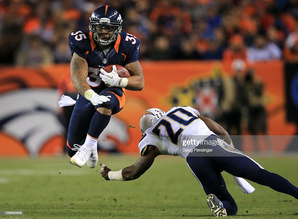 Running back <a gi-track='captionPersonalityLinkClicked' href=/galleries/search?phrase=Lance+Ball&family=editorial&specificpeople=2195338 ng-click='$event.stopPropagation()'>Lance Ball</a> #35 of the Denver Broncos rushes for a first down as he eludes cornerback <a gi-track='captionPersonalityLinkClicked' href=/galleries/search?phrase=Antoine+Cason&family=editorial&specificpeople=2803078 ng-click='$event.stopPropagation()'>Antoine Cason</a> #20 of the San Diego Chargers at Sports Authority Field at Mile High on November 18, 2012 in Denver, Colorado. The Broncos defeated the Chargers 30-23.