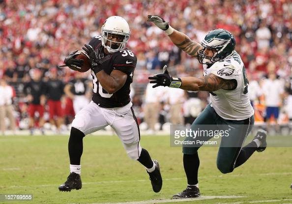 Running back LaRod StephensHowling of the Arizona Cardinals rushes the football past defensive end Jason Babin of the Philadelphia Eagles during the...