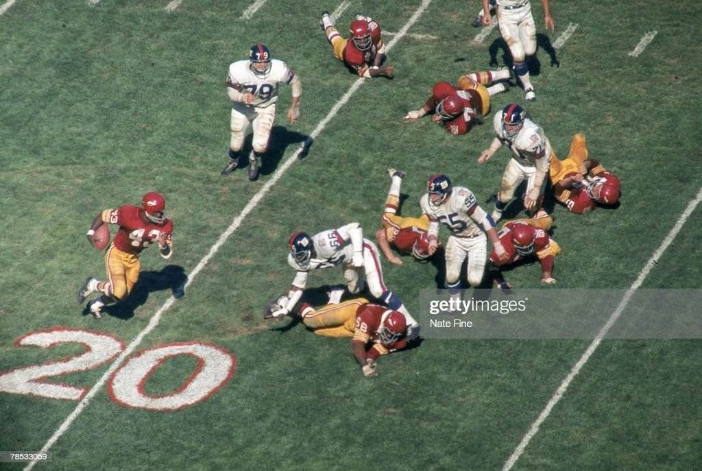 Running back Larry Brown of the Washington Redskins runs upfield against the New York Giants on October 19 1969 at RFK Stadium in Washington DC The...