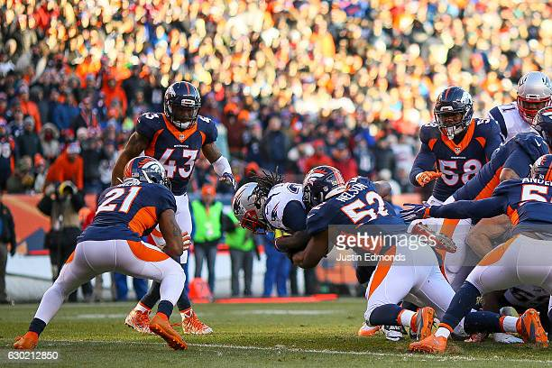 Running back LeGarrette Blount of the New England Patriots dives into the end zone for a second quarter 1yard rushing touchdown against the Denver...