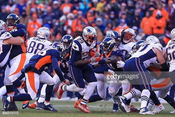 Running back LeGarrette Blount of the New England Patriots rushes against the Denver Broncos in the second quarter at Sports Authority Field at Mile...
