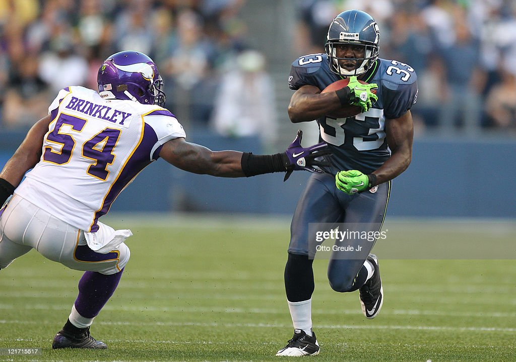 Running back Leon Washington of the Seattle Seahawks rushes against Jasper Brinkley of the Minnesota Vikings at CenturyLink Field on August 20 2011...