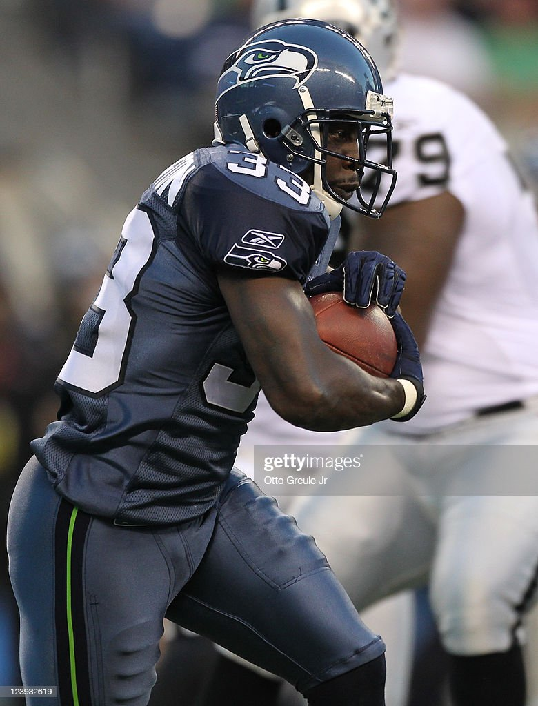 Running back Leon Washington of the Seattle Seahawks rushes against the Oakland Raiders at CenturyLink Field on September 2 2011 in Seattle Washington