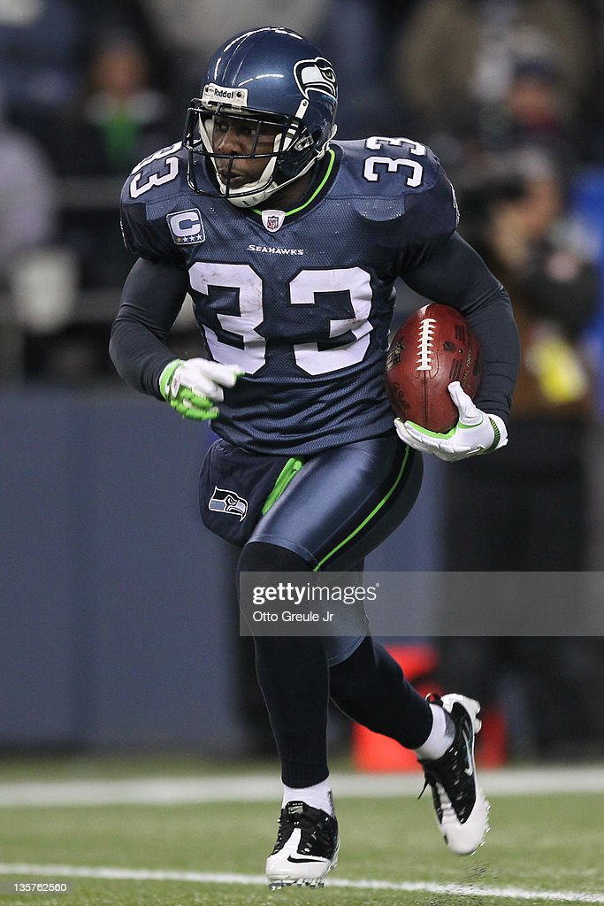 Running back Leon Washington of the Seattle Seahawks rushes against the St Louis Rams at CenturyLink Field on December 12 2011 in Seattle Washington