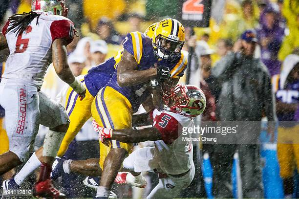 Running back Leonard Fournette of the LSU Tigers attempts to run the ball through defensive back Wonderful Terry of the Western Kentucky Hilltoppers...