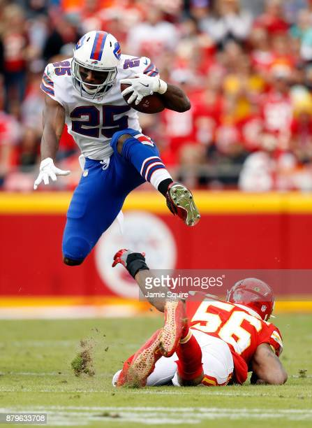 Running back LeSean McCoy of the Buffalo Bills leaps over inside linebacker Derrick Johnson of the Kansas City Chiefs during the game at Arrowhead...