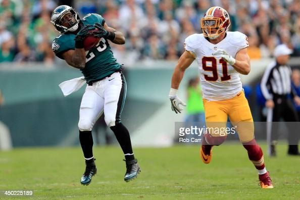 Running back LeSean McCoy of the Philadelphia Eagles catches a pass in front of outside linebacker Ryan Kerrigan of the Washington Redskins during...