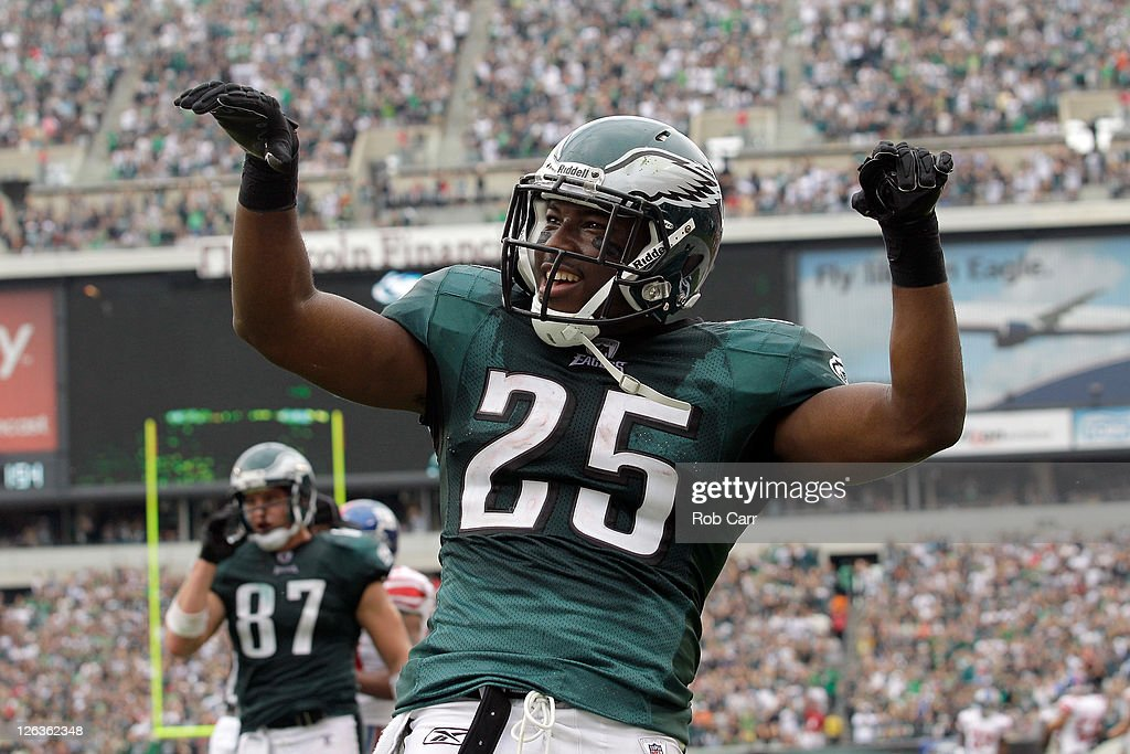 Running back <a gi-track='captionPersonalityLinkClicked' href=/galleries/search?phrase=LeSean+McCoy&family=editorial&specificpeople=4484228 ng-click='$event.stopPropagation()'>LeSean McCoy</a> #25 of the Philadelphia Eagles celebrates after scoring a touchdown against the New York Giants during the second quarter at Lincoln Financial Field on September 25, 2011 in Philadelphia, Pennsylvania.
