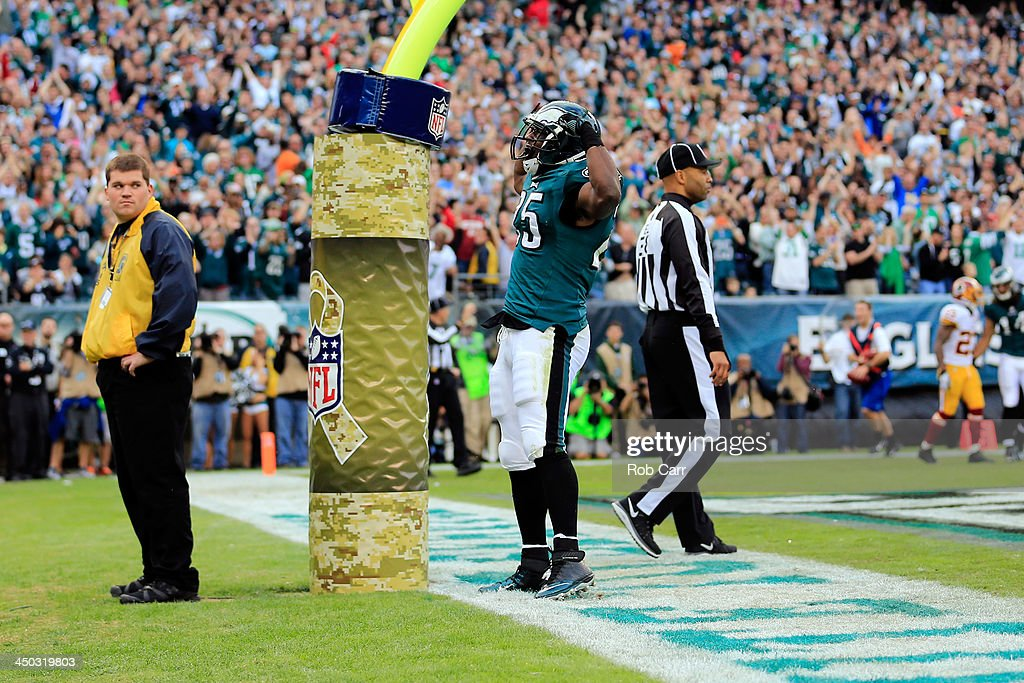 Running back <a gi-track='captionPersonalityLinkClicked' href=/galleries/search?phrase=LeSean+McCoy&family=editorial&specificpeople=4484228 ng-click='$event.stopPropagation()'>LeSean McCoy</a> #25 of the Philadelphia Eagles celebrates after scoring a first half touchdown against the Washington Redskins at Lincoln Financial Field on November 17, 2013 in Philadelphia, Pennsylvania.