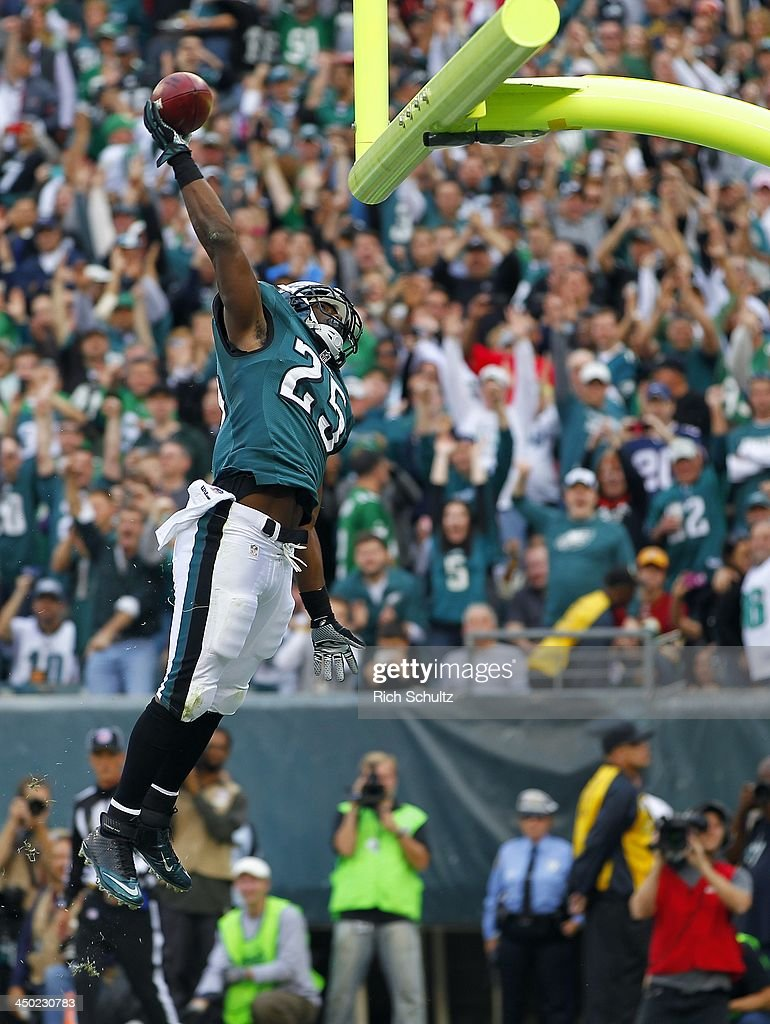 Running back <a gi-track='captionPersonalityLinkClicked' href=/galleries/search?phrase=LeSean+McCoy&family=editorial&specificpeople=4484228 ng-click='$event.stopPropagation()'>LeSean McCoy</a> #25 of the Philadelphia Eagles dunks the ball over the cross bar after scoring a second quarter touchdown against the Washington Redskins during a game at Lincoln Financial Field on November 17, 2013 in Philadelphia, Pennsylvania.