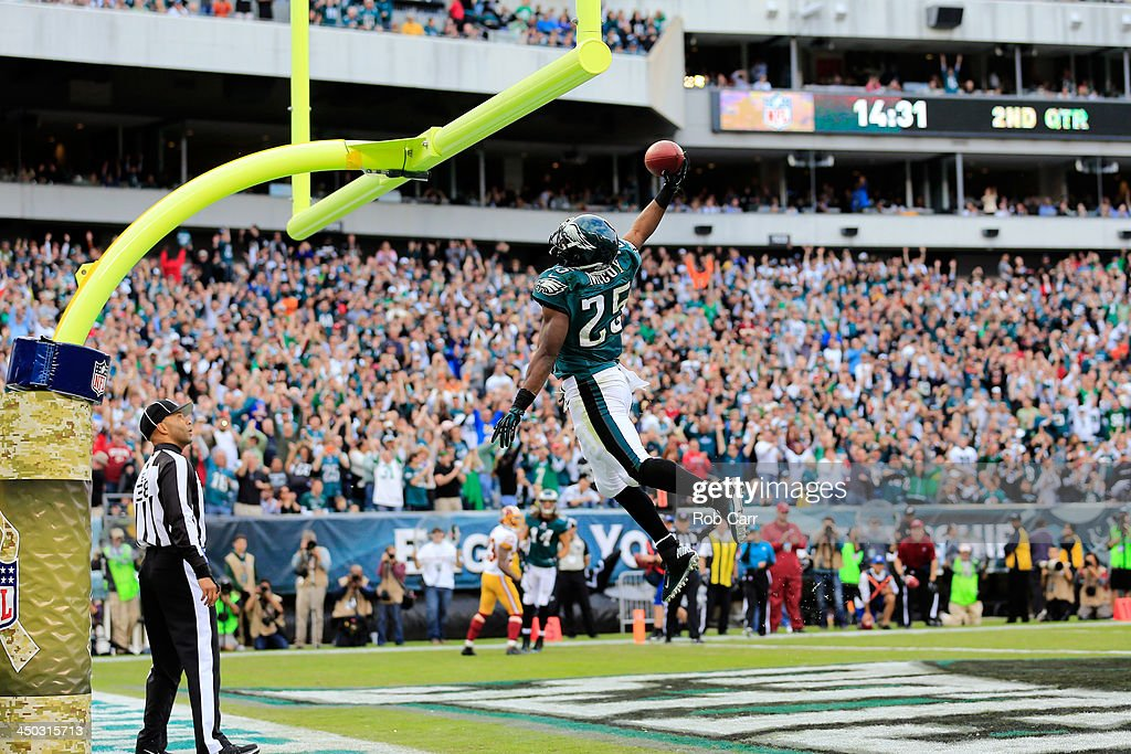 Running back LeSean McCoy #25 of the Philadelphia Eagles dunks the ball over the goal post after scoring a first half touchdown against the Washington Redskins at Lincoln Financial Field on November 17, 2013 in Philadelphia, Pennsylvania.