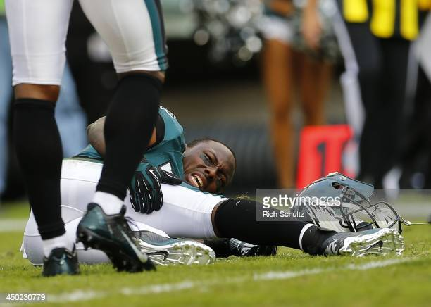 Running back LeSean McCoy of the Philadelphia Eagles holds his leg in pain after being tackled against the Washington Redskins in the second quarter...