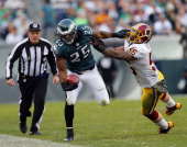 Running back LeSean McCoy of the Philadelphia Eagles is pushed out of bounds by linebacker Perry Riley of the Washington Redskins during the third...
