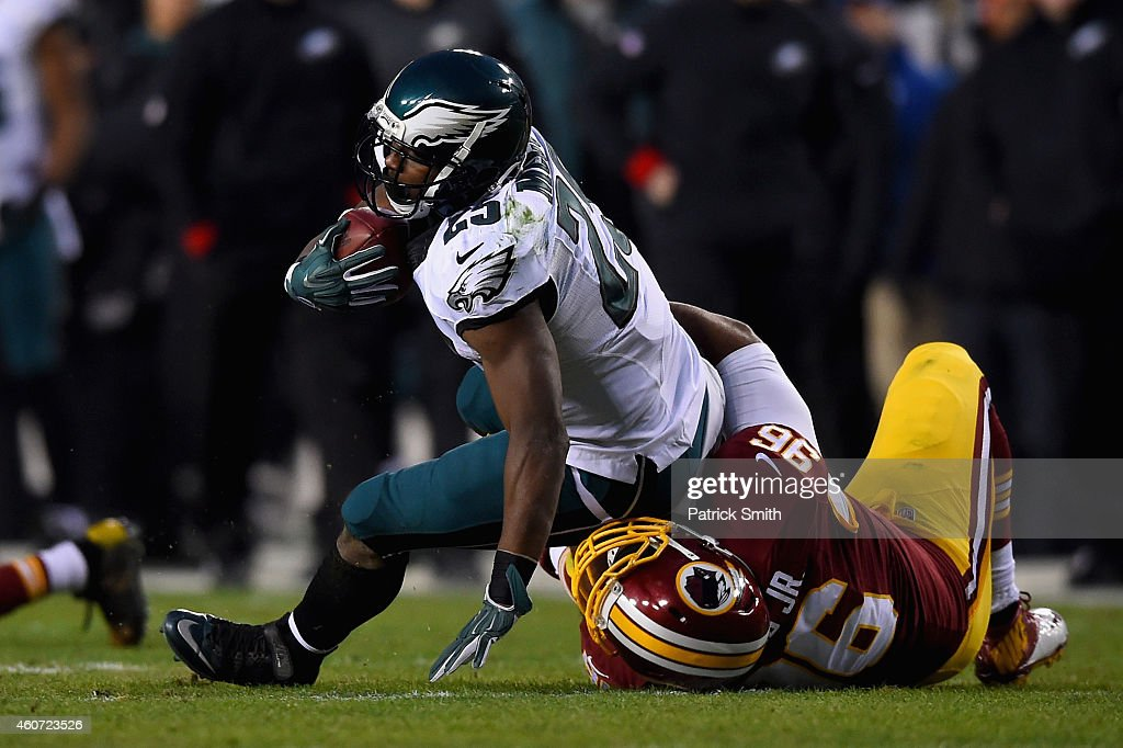 Running back LeSean McCoy of the Philadelphia Eagles is tackled by nose tackle Barry Cofield of the Washington Redskins in the first quarter of a...