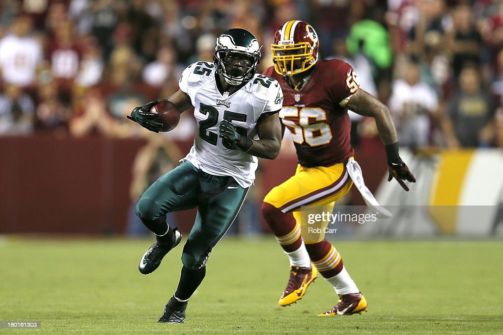 Running back LeSean McCoy of the Philadelphia Eagles runs the ball in front of inside linebacker Perry Riley of the Washington Redskins in the first...