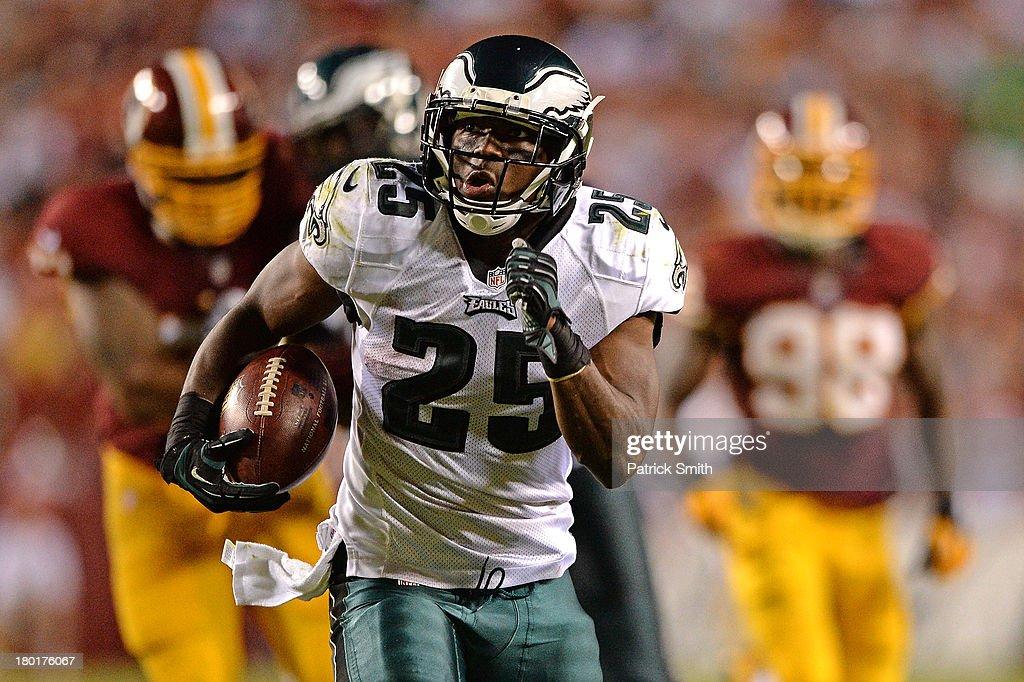 Running back <a gi-track='captionPersonalityLinkClicked' href=/galleries/search?phrase=LeSean+McCoy&family=editorial&specificpeople=4484228 ng-click='$event.stopPropagation()'>LeSean McCoy</a> #25 of the Philadelphia Eagles rushes for a touchdown against the Washington Redskins in the third quarter at FedExField on September 9, 2013 in Landover, Maryland. The Philadelphia Eagles won, 33-27.