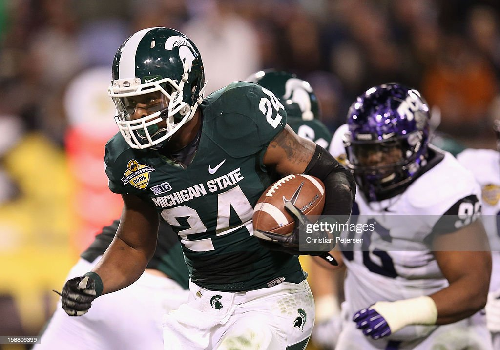 Running back Le'Veon Bell #24 of the Michigan State Spartans rushes the football against the TCU Horned Frogs during the Buffalo Wild Wings Bowl at Sun Devil Stadium on December 29, 2012 in Tempe, Arizona. The Spartans defeated the Horned Frogs 17-16.
