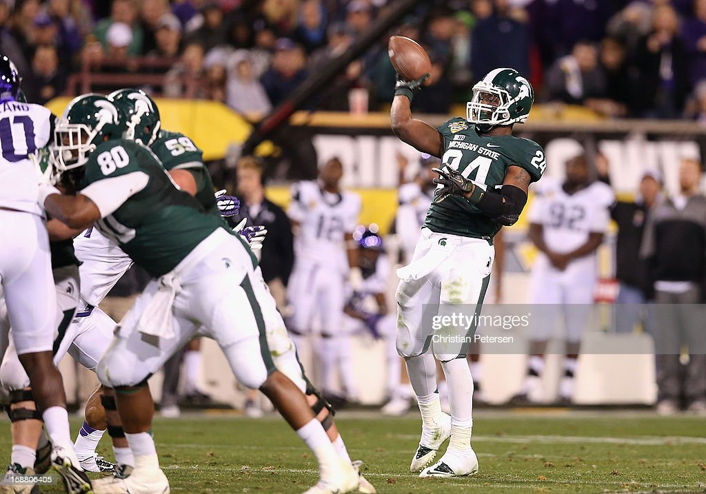 Running back Le'Veon Bell #24 of the Michigan State Spartans throws a 29 yard pass during the third quarter of the Buffalo Wild Wings Bowl against the TCU Horned Frogs at Sun Devil Stadium on December 29, 2012 in Tempe, Arizona. The Spartans defeated the Horned Frogs 17-16.